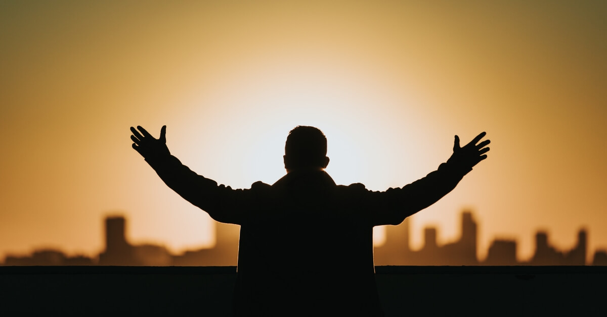silhouette of a man with outstretched arms