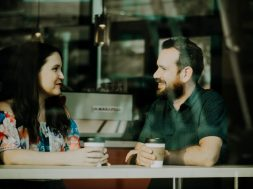 man and woman talking over coffee-2