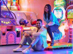 man and woman sitting in an arcade-2