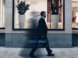 man walking past a store-2