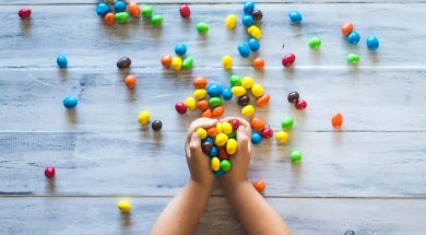 kid-holding-coloured-candy-2.jpg