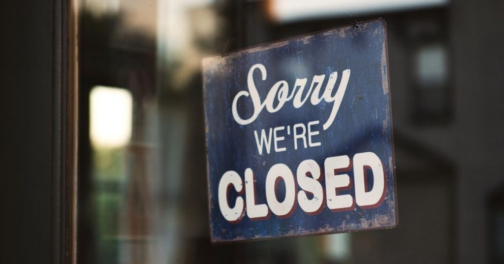 photo of a sign hanging on the glass of a shop which says sorry we're closed. People may no longer assume they will have accessibility to everything they want and need after covid-19