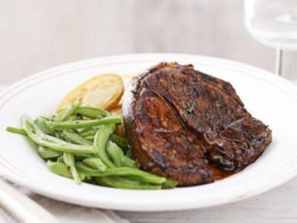 photo of lamb steak and potato on a plate