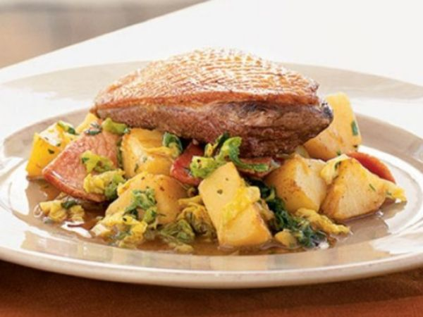 photo shows a plate with simmered duck, cabbage and potatoes
